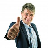 A businessman in a suit giving the thumbs-up sign (the thumb appearing big)