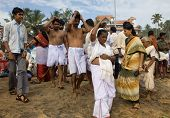 Kerala - August 9: Hindus Walk Down To The Sea To Offer Puja For Their Dead. August 9, 2010 In Keral