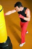 Kickboxer punching the sandbag