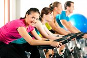 stock photo of training gym  - Group Of Four People In The Gym - JPG