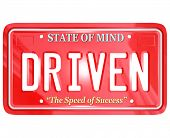 A red license plate with the word Driven, symbolizing good attitude, ambition and diligence to reach success in working toward a goal in life