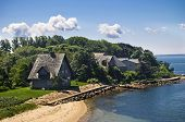stock photo of cape-cod  - A view of the shoreline along Woods Hole on Cape Cod in