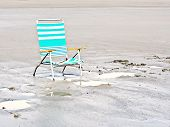 Turquoise Beach Chair on Wet Sand