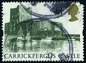 ENGLAND-CIRCA 1992:A stamp printed in ENGLAND shows image of Carrickfergus Castle is a Norman castle
