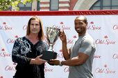 LOS ANGELES - JUL 28:  Fabio, Isaiah Mustafa at a public appearance to promote the Epic Old Spice Challenge  at The Grove on July 28, 2011 in Los Angeles, CA