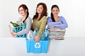 foto of reprocess  - Three young women recycling - JPG