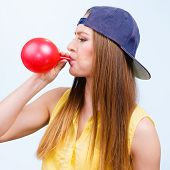 Teen Girl Blowing Red Balloon. poster
