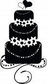 image of three tier  - A round three tiered wedding cake with two hearts on top representing the bride and groom - JPG