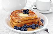 Delicious Stack Of French Toast With Syrup And Fresh Blueberries.