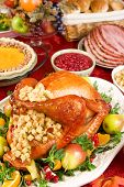 picture of turkey dinner  - Holiday dinner with roast turkey pumpkin pie cranberry chutney baked ham dinner rolls and fruits - JPG