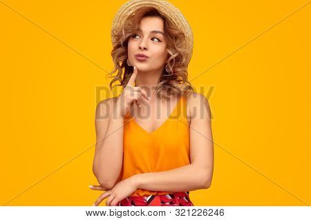 poster of Pretty Young Woman In Trendy Summer Outfit Touching Chin And Looking Away While Thinking Against Vib