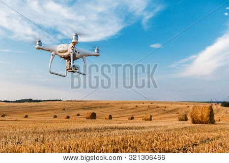 poster of drone quad copter on yellow field
