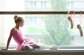 Young Ballerina Looking On Rain Outside The Window. Cute Ballet Girl In Pink Leotard Sitting On Wind poster