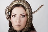 Beautiful Brunette Girl With A Snake Around Her Head