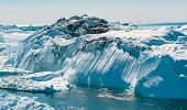 Iceberg and ice from glacier in arctic nature landscape on Greenland. Aerial photo drone photo of ic poster