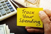 Track Your Spending Sign And Book With Home Budget. poster