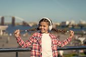 Happiness Is For Now. Little Girl Listen To Music Outdoor. Happy Child Wear Headphones. Little Music poster