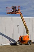 image of cherry-picker  - Cherry picker on construction site in elevated position - JPG