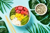 Tuna Poke Bowl With Rice, Avocado, Mango And Cucumber On Blue Background. Top View. Asian Style Food poster