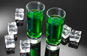 picture of absinthe  - Two glasses of absinthe and ice on grey background - JPG
