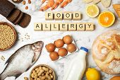 Flat Lay Composition Of Different Products And Wooden Cubes With Words Food Allergy On White Marble  poster