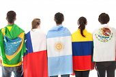 Group of Latinamerican people with the flags - isolated over a white background