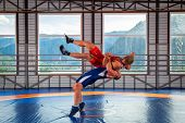 Greco-roman Wrestling Training, Grappling. Two Greco-roman  Wrestlers In Red And Blue Uniform Wrestl poster