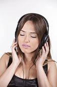 Beautiful Cheerful Young Woman Enjoying Music