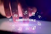 Finger touching tablet with drawn social media icons and GENERATION Z inscription, social networking poster