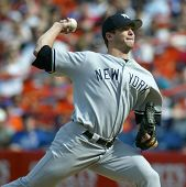 NEW YORK - MAY 20: Mike Mussina #35 of the New York Yankees pitches against the New York Mets on May 20, 2006 at Shea Stadium in Flushing, New York.