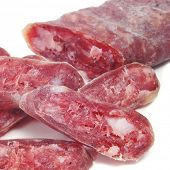 some fuet, spanish salami, on a white background