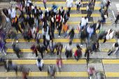 stock photo of hustle  - Busy Crossing Street in Hong Kong - JPG
