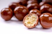 stock photo of malt  - Close up of milk chocolate malt balls - JPG