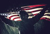 Proud American Army Soldier With National Flag In Hands During Heavy Thunderstorm And Rainfall. Unit poster