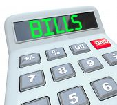 A plastic calculator showing the word Bills representing time to pay off your expenses with payments