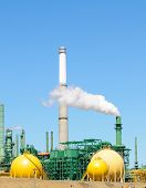stock photo of belching  - Oil refinery belching smoke - JPG