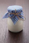 Homemade Milk Yogurt In Glass Pot On Wooden Table