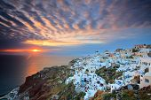 Sunset At Oia Village On Santorini Island, Greece