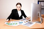 Businesswoman With Financial Report