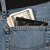 Wallet With Money In  Hip-Pocket Of Jeans