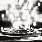 Vinyl record spinning on turntable