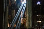 stock photo of milan  - The Bright Beam of Light Inside Milan Cathedral Italy - JPG