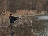 Young Angler Fishing Spinning