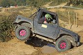 Offroad Car Is Overcoming A Difficult Terrain