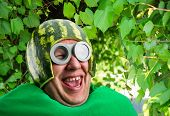 foto of parasite  - Funny man with watermelon helmet and googles looks like a parasitic caterpillar - JPG