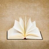 Open Old Book On Brown Canvas Background