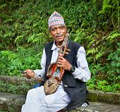 POKHARA - MAY 22: Unidentified Nepalese playing a kind of fiddle, traditional musical  instrument, o