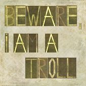 image of troll  - Earthy textured background image and design element depicting the words  - JPG