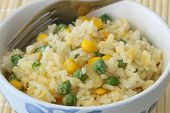 Fried rice with egg, green peas and sweetcorn