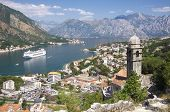 stock photo of historical ship  - Kotor Bay and bell tower of Our Lady of Salvation - JPG